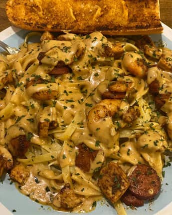 Cajun fettuccini Alfredo with shrimp, chicken, and spicy andouille sausage